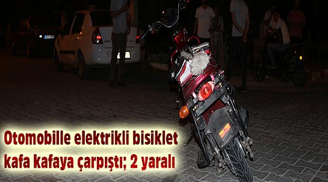 Otomobille elektrikli bisiklet kafa kafaya çarpıştı; 2 yaralı